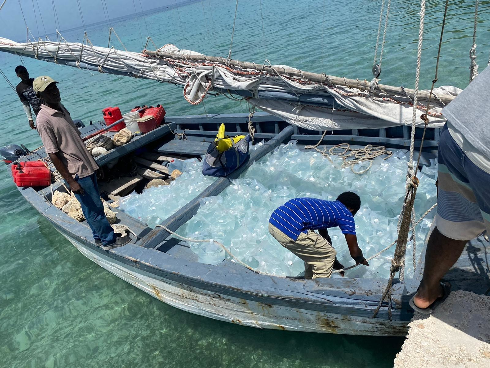 Clean water from GivePower's Solar Water Farm arrives in Les Cayes.